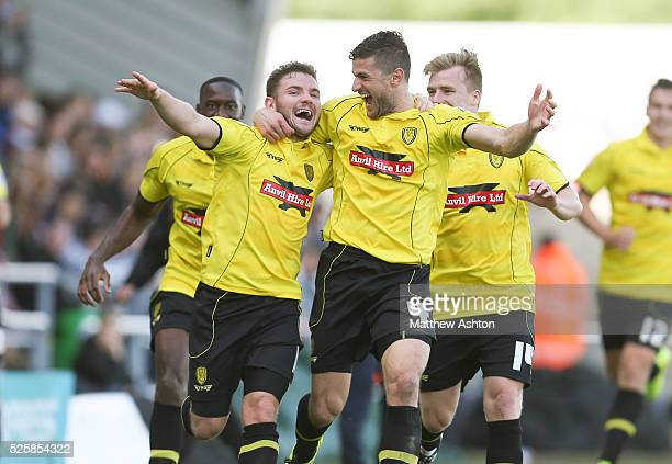 Alex MacDonald of Burton Albion celebrates with John Mousinho of Burton Albion after scoring a goal to make it 12
