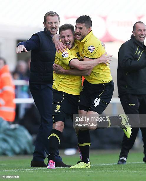 Alex MacDonald of Burton Albion runs past a jubilant Gary Rowett manager of Burton Albion as he celebrates after scoring a goal to make it 12 with...