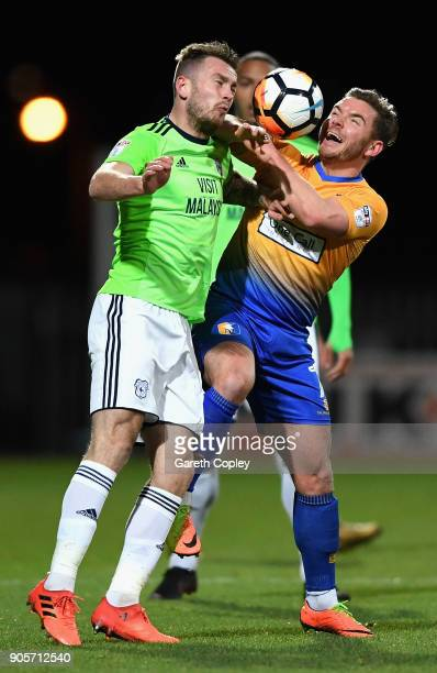 Alex MacDonald of Mansfield Town and Joe Bennett of Cardiff City battle for the ball during The Emirates FA Cup Third Round Replay match between...