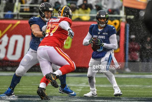 Alex Mack of the Atlanta Falcons blocks for Russell Wilson of the Seattle Seahawks in action during the 2019 NFL Pro Bowl at Camping World Stadium on...