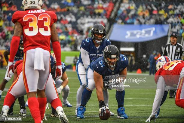 Alex Mack of the Atlanta Falcons gets ready to snap the ball to Russell Wilson of the Seattle Seahawks during the 2019 NFL Pro Bowl at Camping World...