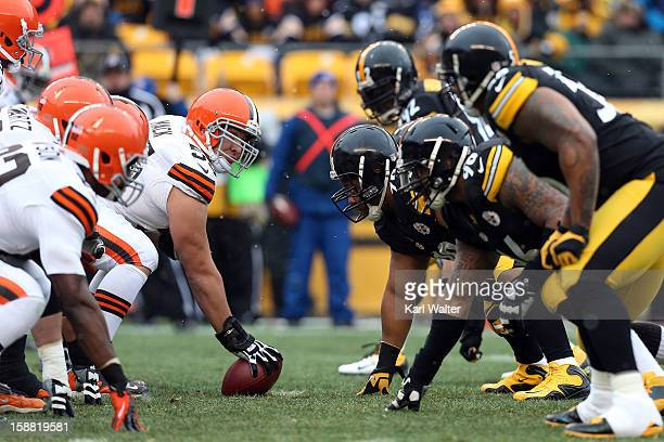 Alex Mack of the Cleveland Browns lines up against Casey Hampton of the Pittsburgh Steelers during their game at Heinz Field on December 30 2012 in...