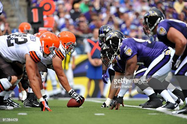 Alex Mack of the Cleveland Browns snaps the ball against the Baltimore Ravens at MT Bank Stadium on September 27 2009 in Baltimore Maryland The...