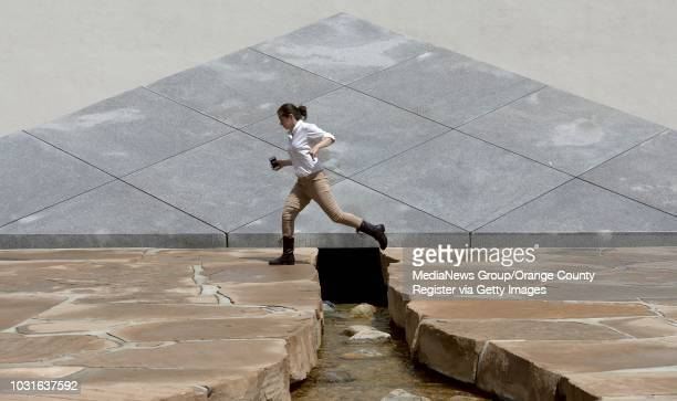 Alex Madayag jumps over a water feature at Noguchi Garden in Costa Mesa. Noguchi Garden was commissioned by Henry Segerstrom in 1979 and is open to...