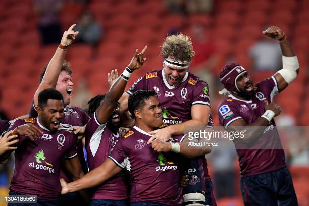 Alex Mafi of the Reds celebrates with team mates after scoring the game winning try during the round two Super RugbyAU match between the Melbourne...