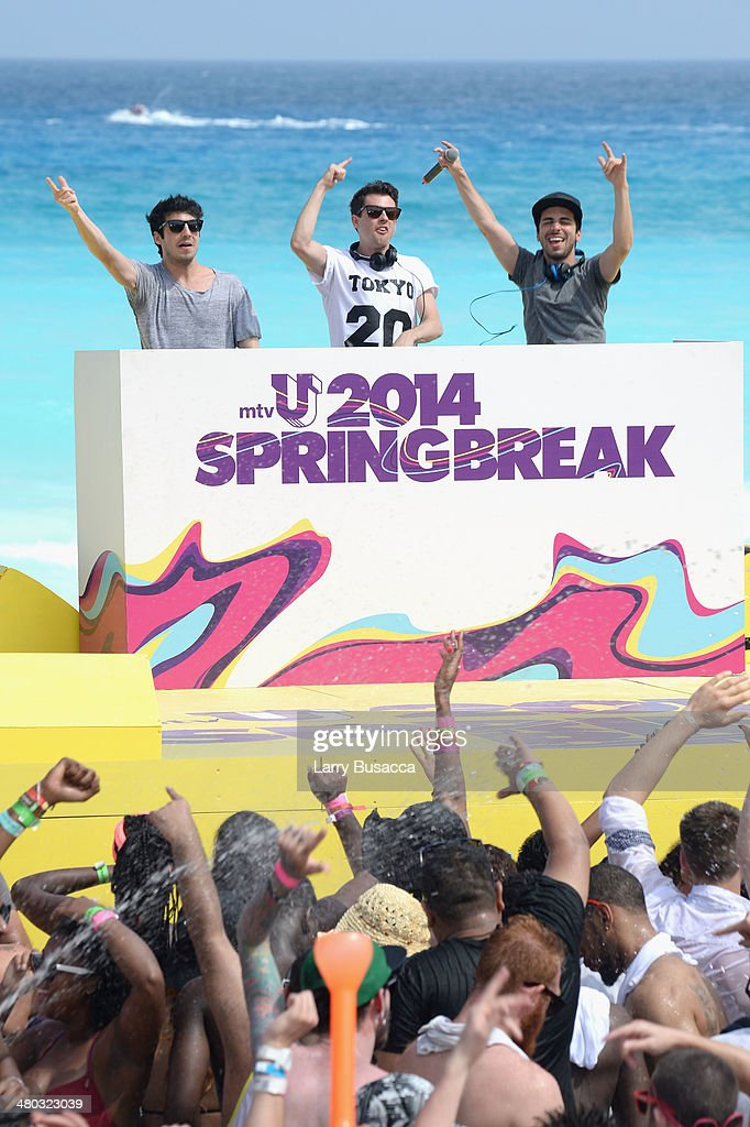 Alex Makhlouf, Samuel Frisch, and Jean Paul Makhlouf of Cash Cash spin onstage at mtvU Spring Break 2014 at the Grand Oasis Hotel on March 21, 2014 in Cancun, Mexico.'mtvU Spring Break' starts airing March 31st on mtvU.