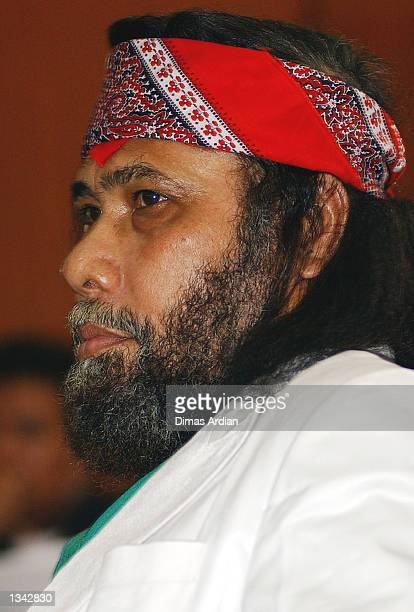 Alex Manuputty, a Christian leader , listens to the prosecutor read the indictment in Jakarta Court August 19, 2002 in Jakarta, Indonesia. Indonesian...