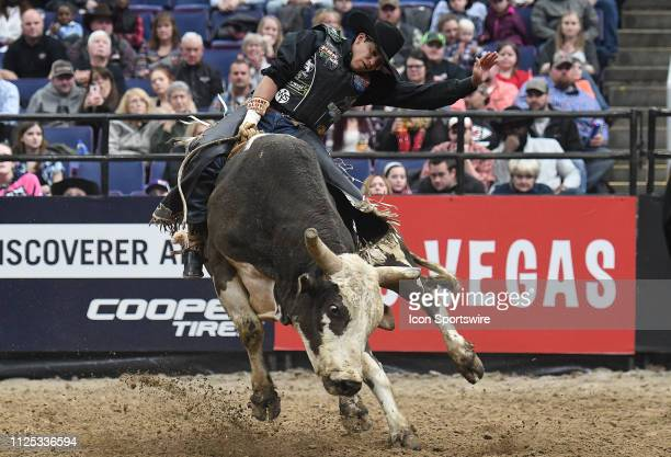Alex Marcilio rides the bull Rojo during the Professional Bullrider's Mason Lowe Memorial on February 15 at Enterprise Center St Louis MO
