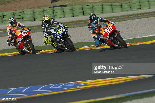 Alex Marquez leads Valentino Rossi of Italy and Movistar Yamaha MotoGP and Marc Marquez of Spain and Repsol Honda Team during the MotoGP Tests in...