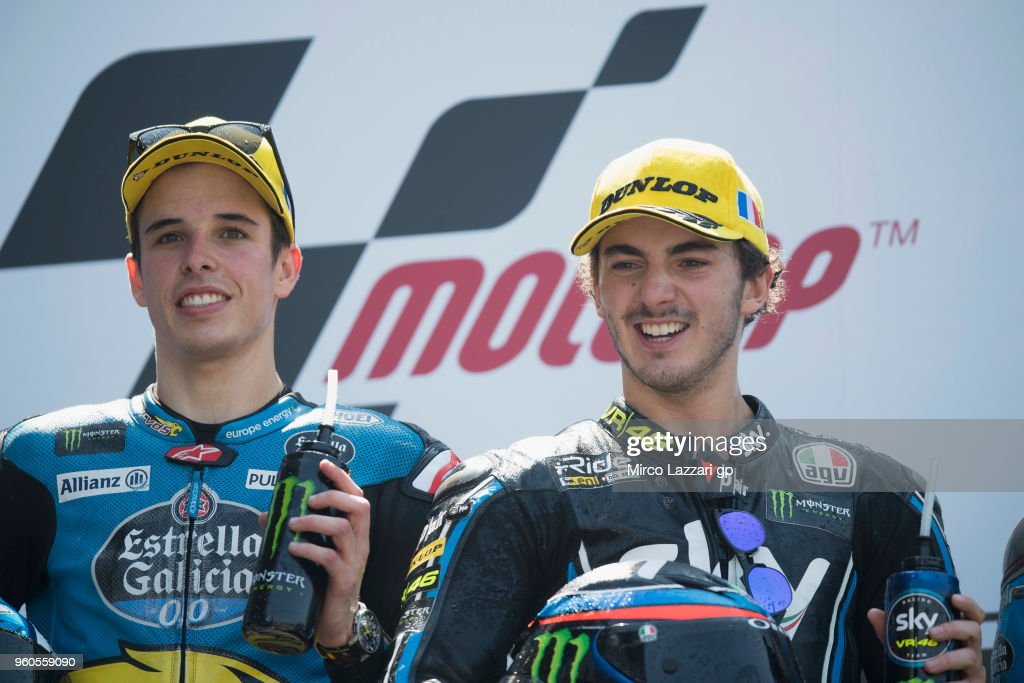 Alex Marquez of Spain and EG 0,0 Marc VDS and Francesco Bagnaia (R) of Italy and Sky Racing Team VR46 celebrate on the podium at the end of the Moto2 race during the MotoGp of France - Race on May 20, 2018 in Le Mans, France.
