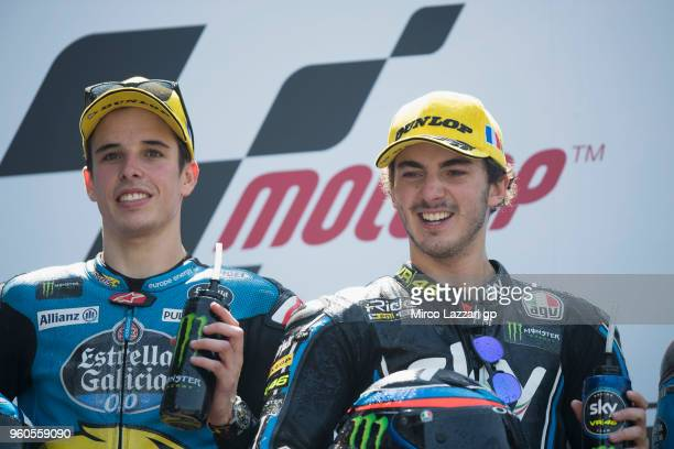 Alex Marquez of Spain and EG 00 Marc VDS and Francesco Bagnaia of Italy and Sky Racing Team VR46 celebrate on the podium at the end of the Moto2 race...