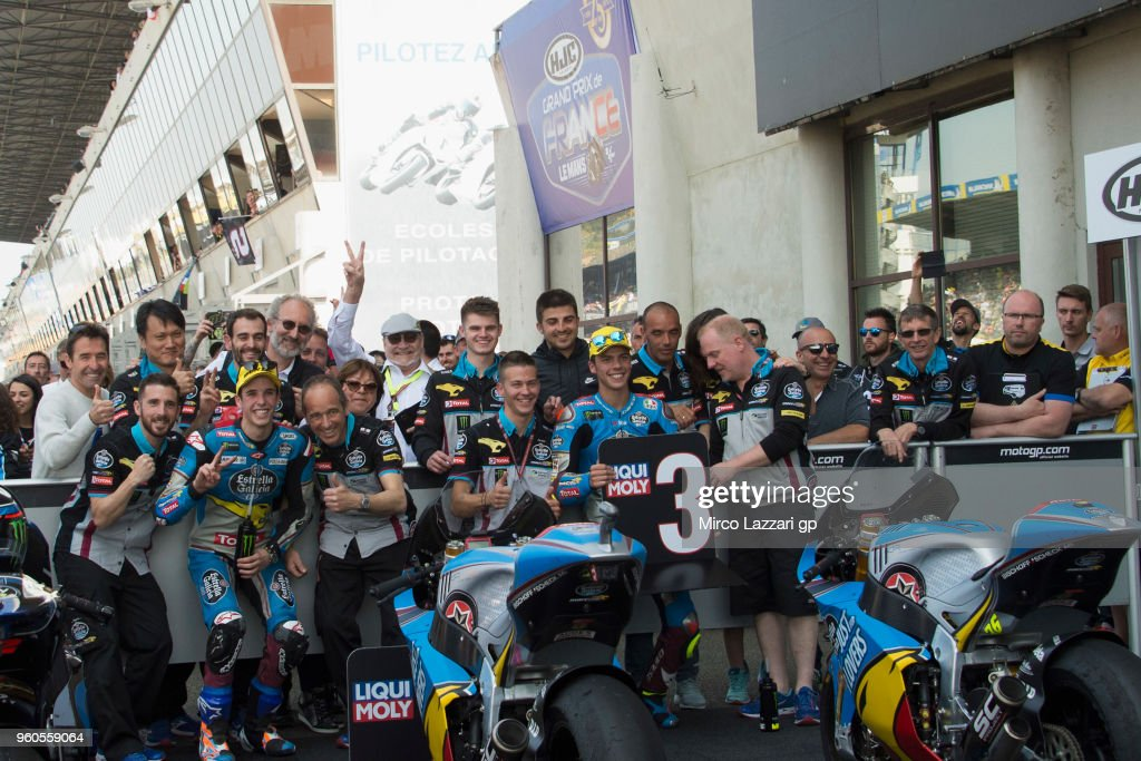 Alex Marquez of Spain and EG 0,0 Marc VDS and Joan Mir of Spain and EG 0,0 Marc VDS (R) celebrate with team under the podium at the end of the Moto2 race during the MotoGp of France - Race on May 20, 2018 in Le Mans, France.