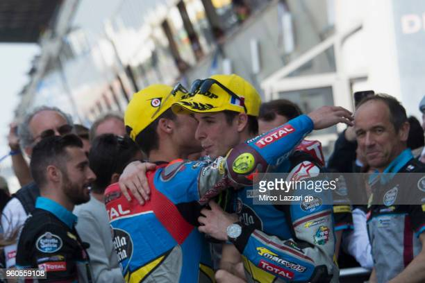 Alex Marquez of Spain and EG 00 Marc VDS and Joan Mir of Spain and EG 00 Marc VDS hug under the podium at the end of the Moto2 race during the MotoGp...