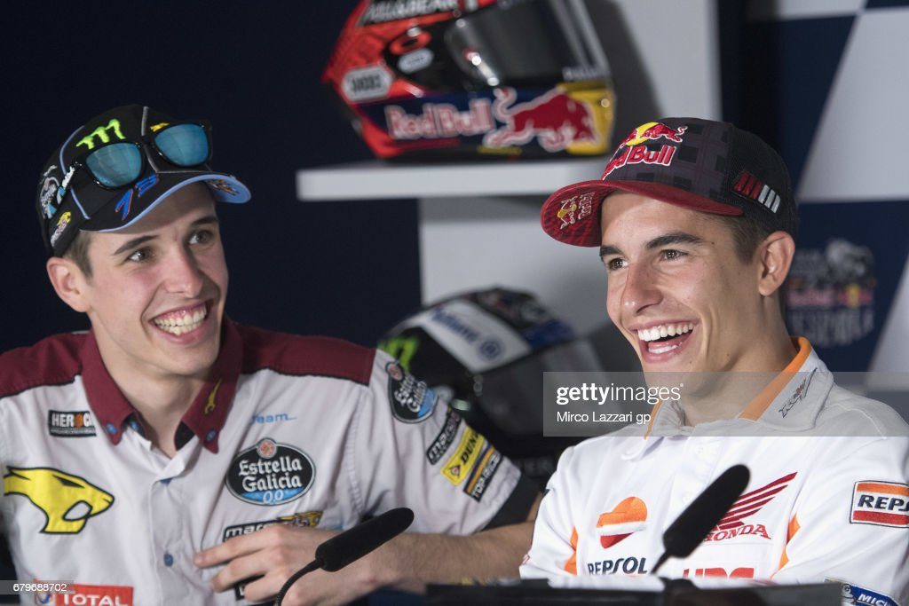 Alex Marquez of Spain and EG 00 Marc VDS and Marc Marquez of Spain and Repsol Honda Team smile during the press conference during the MotoGp of Spain - Qualifying at Circuito de Jerez on May 6, 2017 in Jerez de la Frontera, Spain.