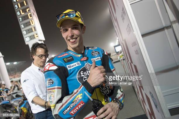 Alex Marquez of Spain and EG 00 Marc VDS celebrates the pole position at the end of the qualifying practice during the MotoGP of Qatar Qualifying at...