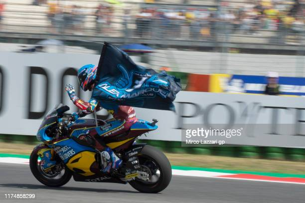 Alex Marquez of Spain and EG 00 Marc VDS celebrates the third place with the flag during the Moto2 race during the MotoGp of San Marino Race at...