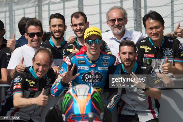 Alex Marquez of Spain and EG 00 Marc VDS celebrates with team the third place in Moto2 at the end of the qualifying practice during the MotoGp of...