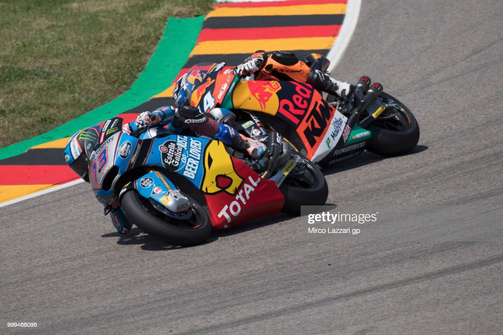 Alex Marquez of Spain and EG 0,0 Marc VDS leads Miguel Oliveira of Portugal and Red Bull KTM Ajo during the Moto2 race during the MotoGp of Germany - Race at Sachsenring Circuit on July 15, 2018 in Hohenstein-Ernstthal, Germany.