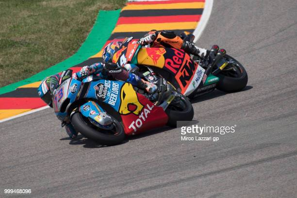 Alex Marquez of Spain and EG 00 Marc VDS leads Miguel Oliveira of Portugal and Red Bull KTM Ajo during the Moto2 race during the MotoGp of Germany...