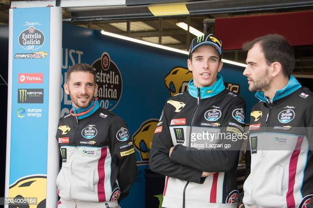 Alex Marquez of Spain and EG 00 Marc VDS speaks with mechanics in box waiting the start of the MotoGP race during the MotoGp Of Great Britain Race at...