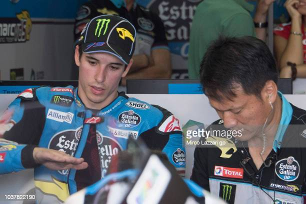 Alex Marquez of Spain and EG 00 Marc VDS speaks with mechanics in box during the qualifying practice during the MotoGP of Aragon Qualifying at...
