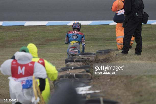 Alex Marquez of Spain and EG 00 Marc VDS walks out of track after crashed out during the MotoGP qualifying during qualifying for the 2018 MotoGP of...
