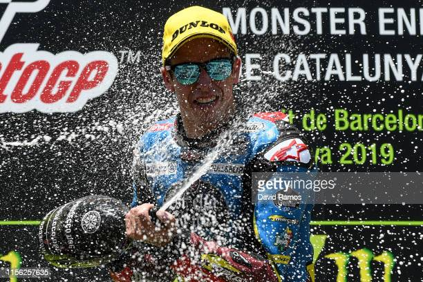 Alex Marquez of Spain and Estrella Galicia 0,0 Marc VDS celebrates on the podium after winning the Moto2 race during the MotoGP Gran Premi Monster...