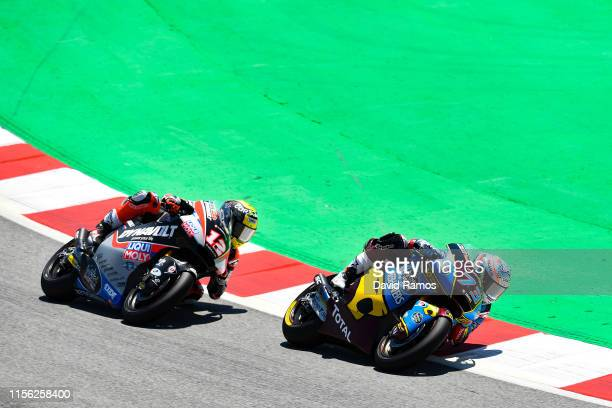Alex Marquez of Spain and Estrella Galicia 0,0 Marc VDS rides in front of Thomas Luthi of Switzerland and Dynavolt Intact GP to win the Moto2 race...