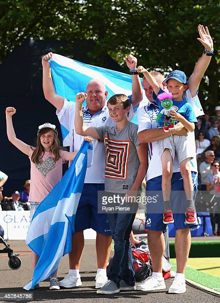 Alex Marshall and Paul Foster of Scotland celebrate victory with their family after winning gold in the Men's Pairs Final at Kelvingrove Lawn Bowls...