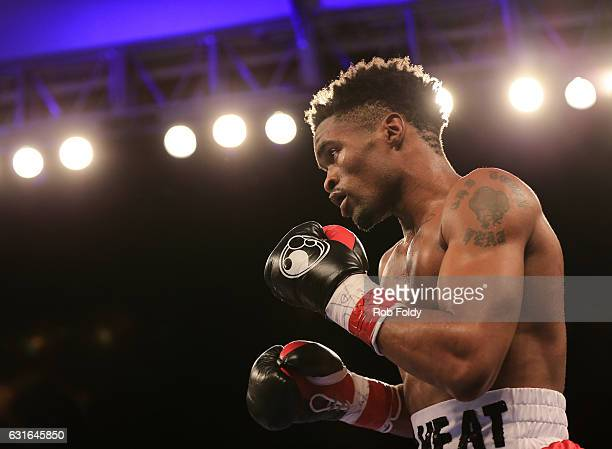 Alex Martin fights against Miguel Cruz during a bout at Hialeah Park on January 13 2017 in Miami Florida