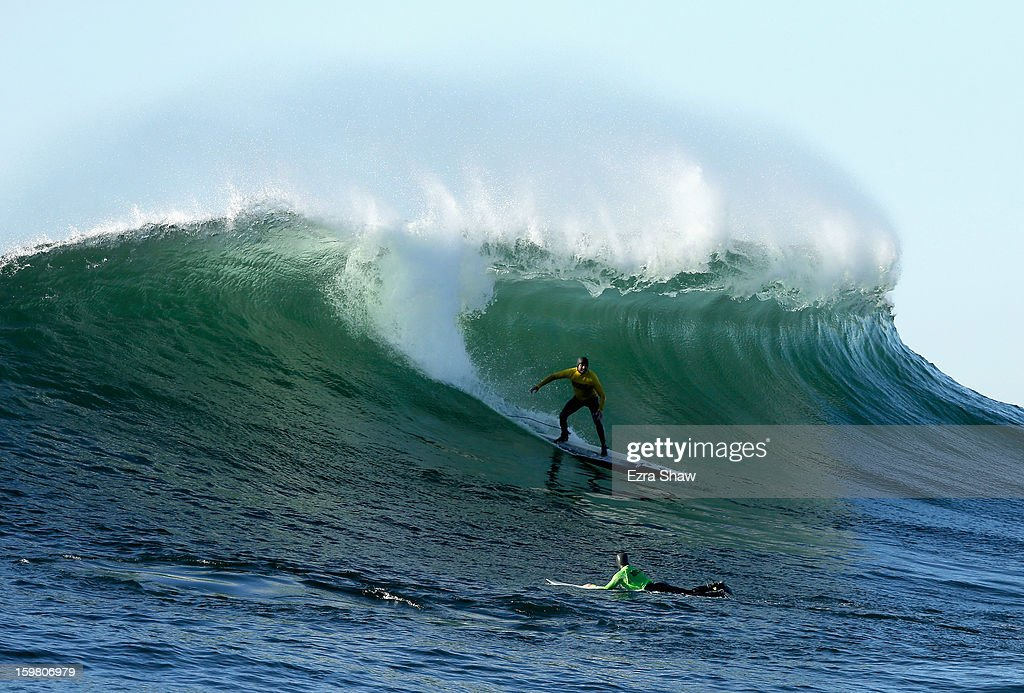 Alex Martins competes in the finals during the Mavericks Invitational surf competition on January 20, 2013 in Half Moon Bay, California.