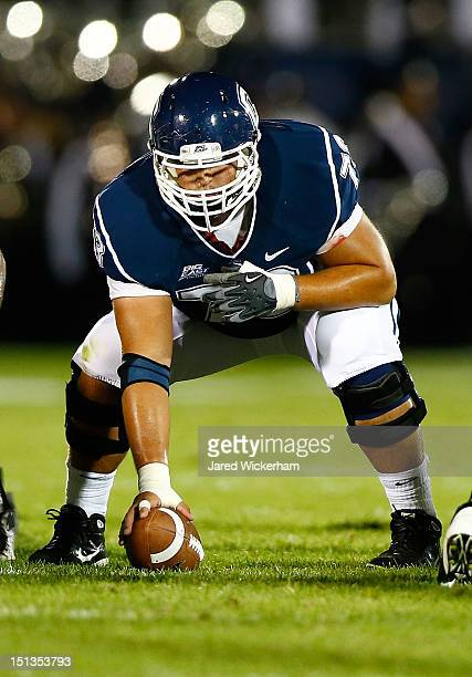 Alex Mateas of the Univeristy of Connecticut Huskies in action against the University of Massachusetts Minutemen during the game on August 30 2012 at...