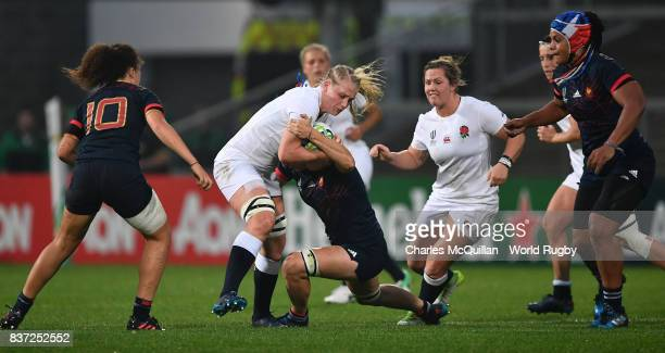 Alex Matthews of England is tackled by Majorie Mayans of France during the Women's Rugby World Cup 2017 Semi Final match between England and France...