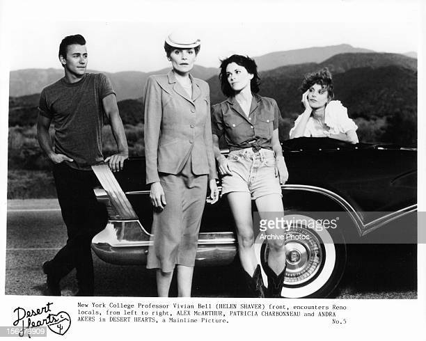 Alex McArthur Helen Shaver Patricia Charbonneau and Andra Akers with a car in a publicity portrait for the film 'Desert Hearts' 1985