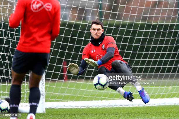 Alex McCarthy makes a save during a Southampton FC training session at Staplewood Complex on March 13 2019 in Southampton England