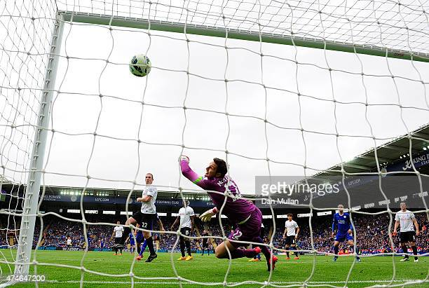 Alex McCarthy of QPR fails to stop a shot from Leonardo Ulloa of Leicester City during the Premier League match between Leicester City and Queens...