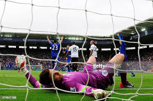 Alex McCarthy of QPR lies dejected after failing to stop a shot from Leonardo Ulloa of Leicester City during the Premier League match between...