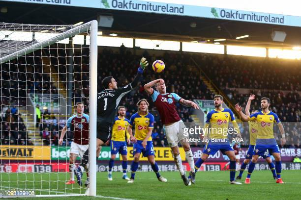 Alex McCarthy of Southampton and Ashley Barnes of Burnley during the Premier League match between Burnley FC and Southampton FC at Turf Moor on...