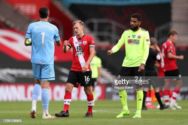 Alex McCarthy of Southampton interacts with teammate James WardProwse at fulltime after the Premier League match between Southampton FC and Sheffield...
