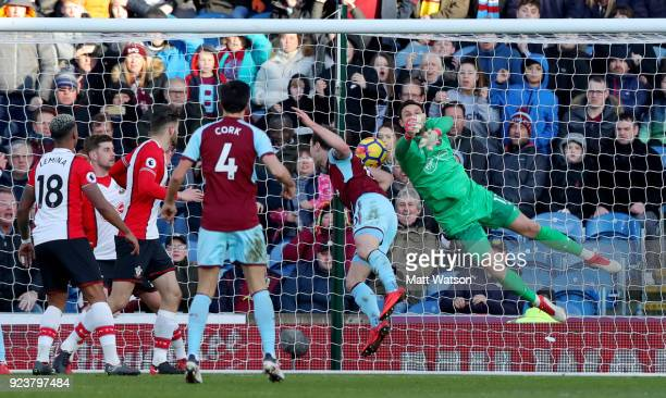 Alex McCarthy of Southampton is beaten to the ball by Ashley Barnes of Burnley who scores during the Premier League match between Burnley and...