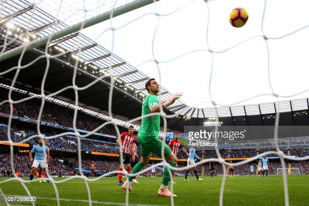 Alex McCarthy of Southampton looks on as David Silva of Manchester City's shot crosses the line for Manchester City's third goal during the Premier...