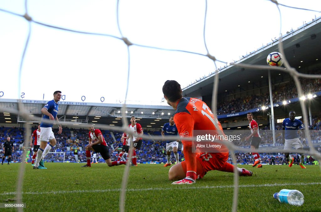 Alex McCarthy of Southampton looks on as Tom Davies of Everton scores his sides first goal during the Premier League match between Everton and Southampton at Goodison Park on May 5, 2018 in Liverpool, England.