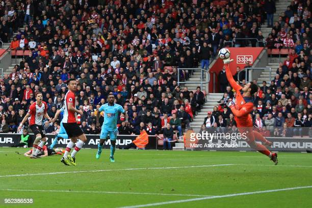 Alex McCarthy of Southampton makes a good save in injury time from Ryan Fraser of AFC Bournemouth during the Premier League match between Southampton...
