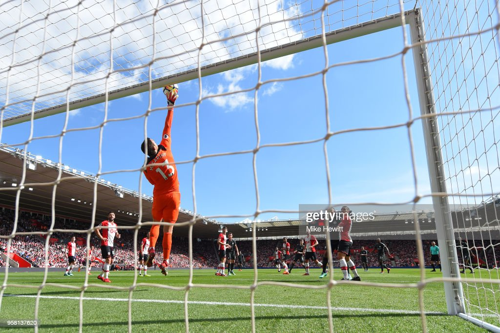 Alex McCarthy of Southampton makes a save during the Premier League match between Southampton and Manchester City at St Mary's Stadium on May 13, 2018 in Southampton, England.