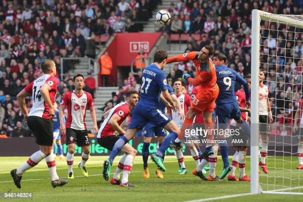 Alex McCarthy of Southampton manages to divert the ball away from Andreas Christensen of Chelsea during the Premier League match between Southampton...