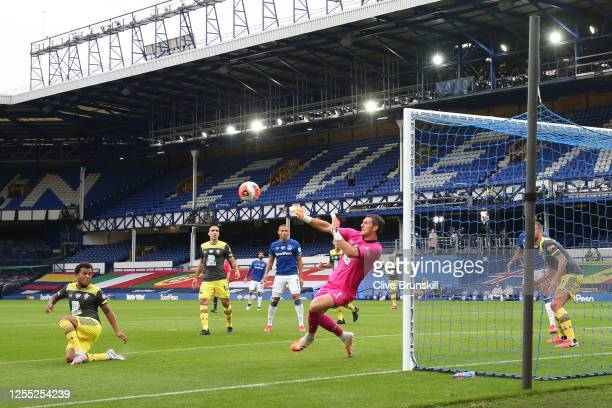 Alex McCarthy of Southampton saves a shot during the Premier League match between Everton FC and Southampton FC at Goodison Park on July 09 2020 in...