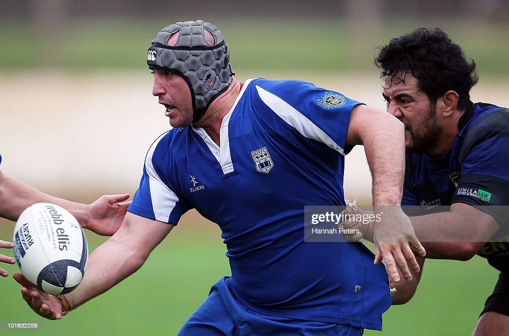 Alex McIntyre of University looks to offload during the club rugby match between Ponsonby and University at Western Springs Stadium on June 5, 2010 in Auckland, New Zealand.