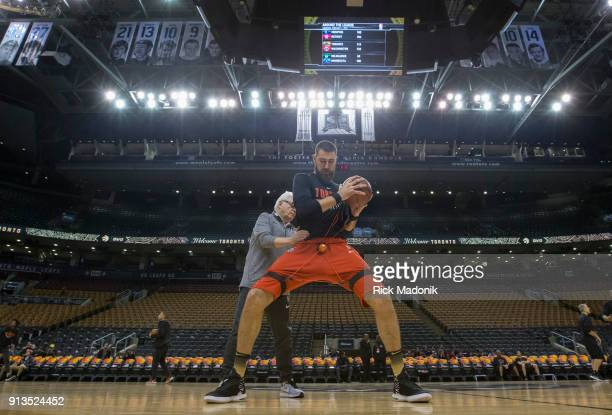 Alex McKennie Director of Sports Medicine works with Jonas Valanciunas prior to the game Toronto Raptors vs Portland Trail Blazers in 1st half action...