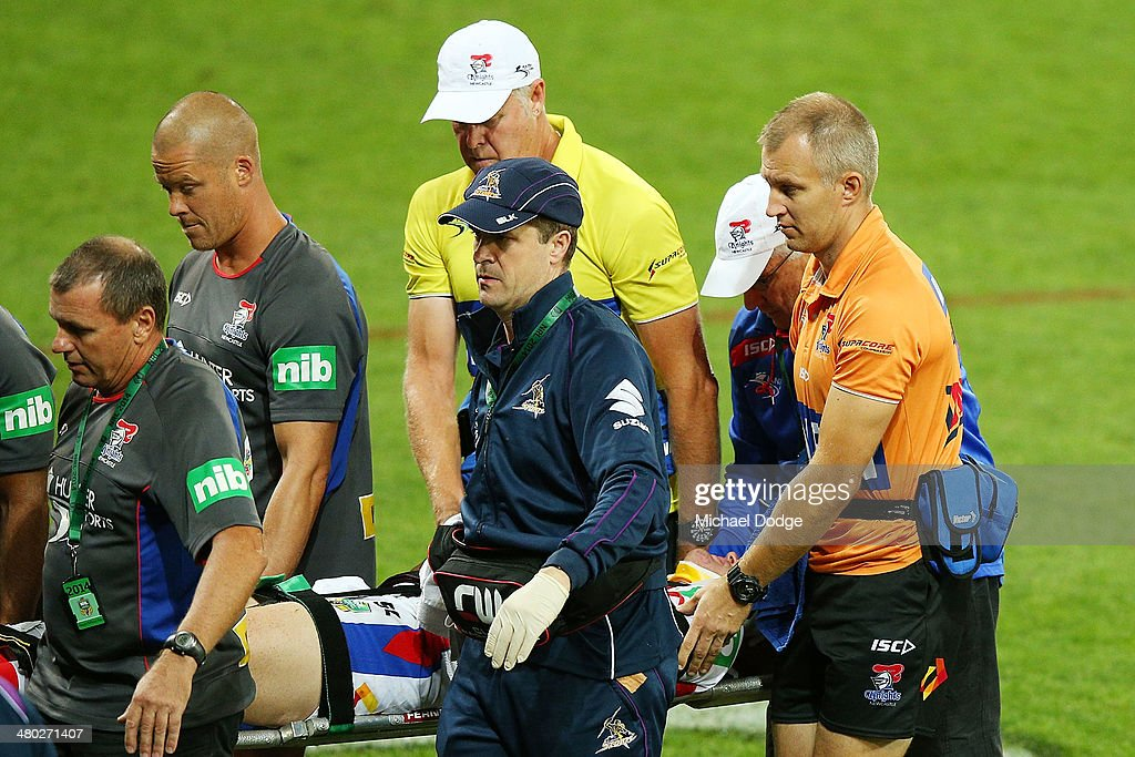 Alex McKinnon of the Knights is carried off an a stretcher after being tackled during the round three NRL match between the Melbourne Storm and the Newcastle Knights at AAMI Park on March 24, 2014 in Melbourne, Australia.
