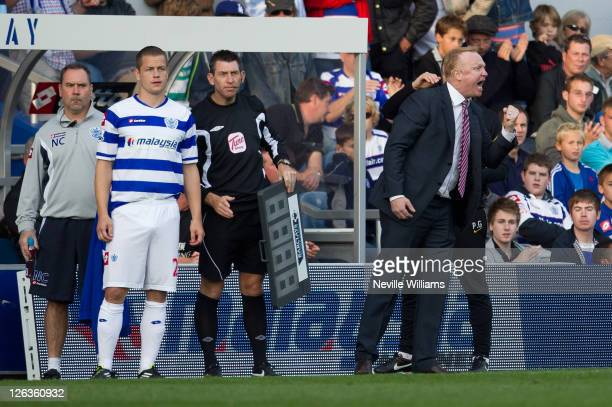 Alex McLeish manager of Aston Villa shouts instructions to his players as Heidar Helguson of QPR prepares to come on as a substitute during the...
